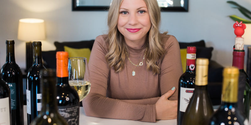 crystal vilkaitis of crystal uncorked with bottles of wine